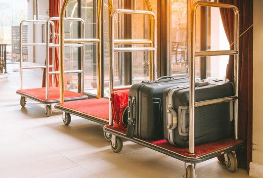 Hotel luggage cart / baggage trolley in the hotel lobby hallway background or Bellman's luggage cart