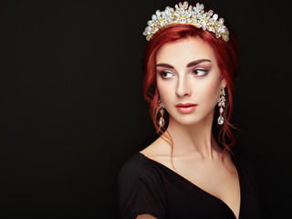 Beautiful girl in the crown and earrings. Perfect makeup. Beauty fashion. Cosmetic. Elegant hairstyle.
