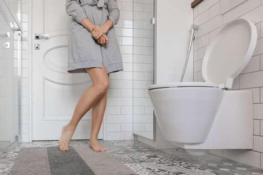 Woman problem holding her hands in toilet
