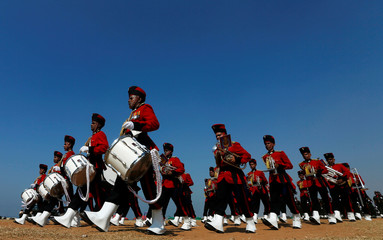 Members of Sri Lanka's military band march with musical instruments during a rehearsal parade for Sri Lanka's 70th Independence day celebrations in Colombo, Sri Lanka