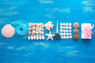 Banner Decorative arrangement of sea shells and stones.