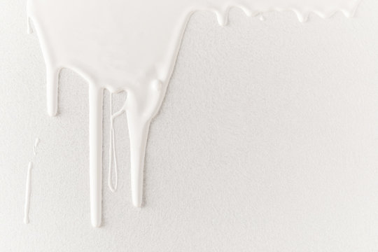 white dripping paint on white surface