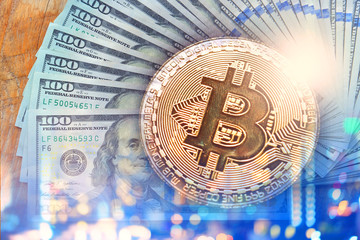 Multiple exposure of bitcoin sign with US dollar bank notes abstract bokeh background for business financial concept.
