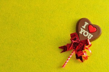 A heart shape chocolate lollipop with the words I love you