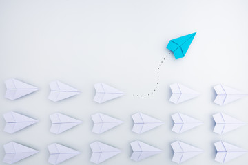 Group of paper planes in one direction and with one individual pointing in the different way. Business concept for innovative solution. Wall mural