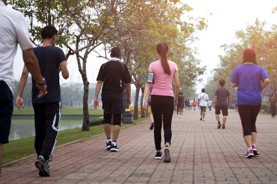 Group of people exercise walking in the park