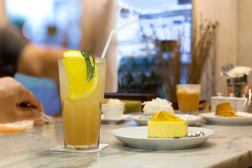 Fresh Lychee juice with soda drink in a glass with lemon and cheese cake