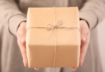 Woman holding parcel gift box, closeup