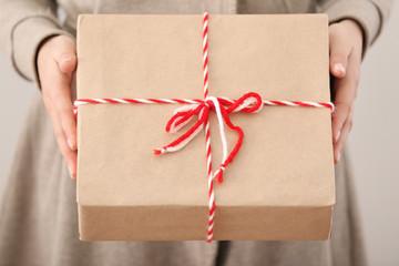 Woman holding parcel gift box, closeup