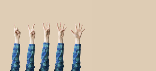 Raised up hands and fingers showing numerical