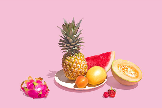 Assortment of Tropical Fruit on Pink Background