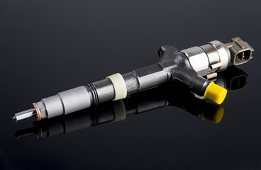 Diesel fuel injector isolated on black