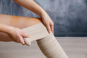 Application of elastic compression bandage