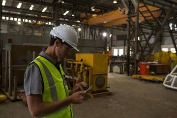 Marine engineer using mobile phone
