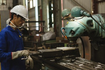 Worker using milling machine