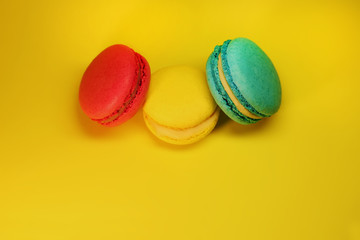Bright food photography of macroons on yellow background
