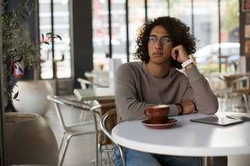 Young man relaxing in cafeteria