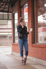 Beautiful woman talking on mobile phone while having coffee