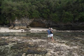 Affectionate senior couple hugging at beach