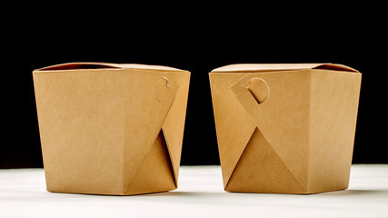 Two closed WOK paper box. Asian fast food concept.