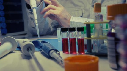 Fototapete - Experiment in a chemical laboratory