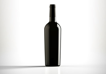 Black bottle of red wine, bordolese conical, still life on a white background.