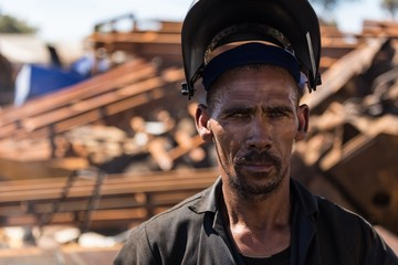 Scrapyard worker looking at the camera