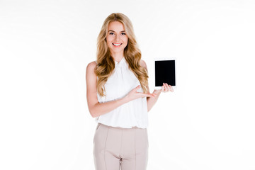 You will fall in love with this tablet! Beautiful young woman showing her digital tablet and looking at camera with smile while standing against white background