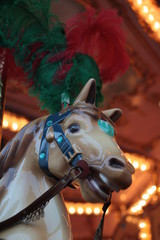 Detail of an antique carousel with horses, taken in the center of Florence.