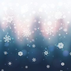 Abstract Christmas background with blurred winter forest, snowflakes and bokeh. Sunset over winter trees.