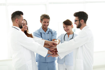 Doctors and nurses stacking hands. concept of mutual aid.