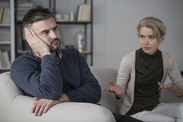 Upset man and complaining wife