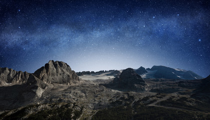 starry night sky in a mountain landscape