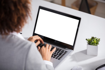 Businesswoman Working On Laptop With Blank Screen
