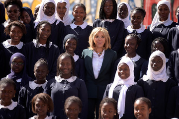 Brigitte Macron, the wife of the French president, poses with pupils of Mariama Ba school on Goree island, once a west African slaving post, off the coast of Dakar