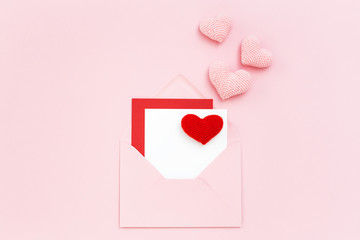 Valentine card in envelope with pink hearts