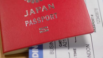 Japanese citizen passport and a flight ticket for a travel