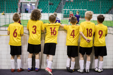 97f00571c Children futsal team. Group of young indoor soccer players sitting ...