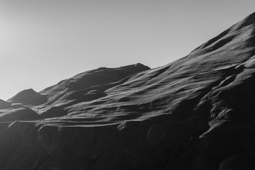 amazing high black mountains on a gray background