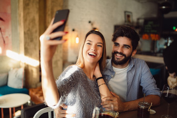 Young attractive couple making selfie.