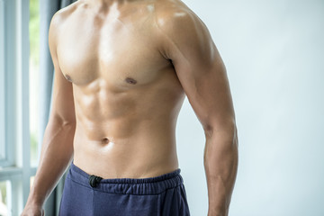 muscular young man with dumbbell healthy concept