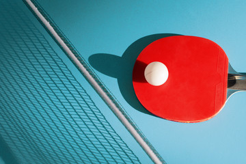 Red racket and a ball for table tennis