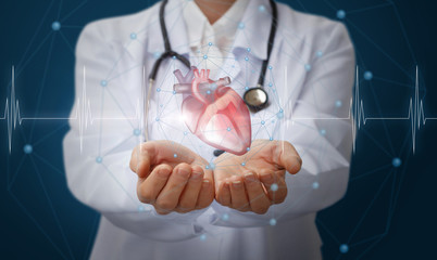 Heart in the hands of the medical worker .