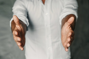 Close up of man's cupped hands show something on white background. Palms up. High resolution product