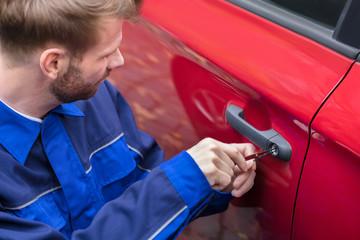 Human Hand Opening Car's Door With Lockpicker