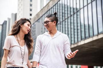 Young Asian Couple Tourist in Paulista Avenue, Sao Paulo, Brazil