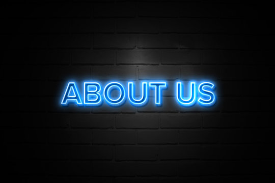 About Us neon Sign on brickwall