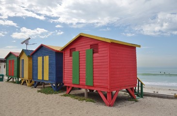 Brightly colored Victorian beach cabin houses on the Muizenberg Beach in Cape Town, South Africa