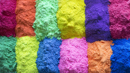 Festival of colors. Bright colors for holi festival. Many colorful holi paint background. Close up with copy space. Natural organic pigment.