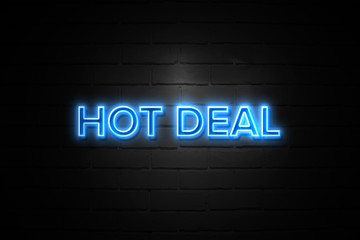 Hot Deal neon Sign on brickwall